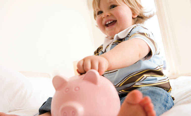 Financing your Home Comfort Solution - smiling boy with piggy bank
